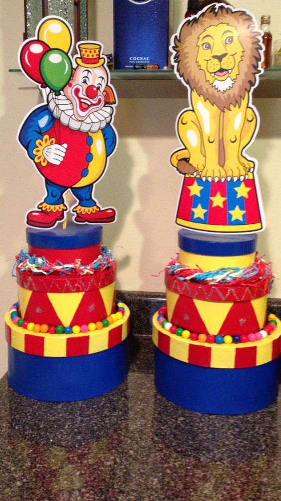 Carnival centerpieces - Darice Paper Mache Round Box, Set of 3, spray paint, gum balls, glitter and as topper a carnival cardboard stand.